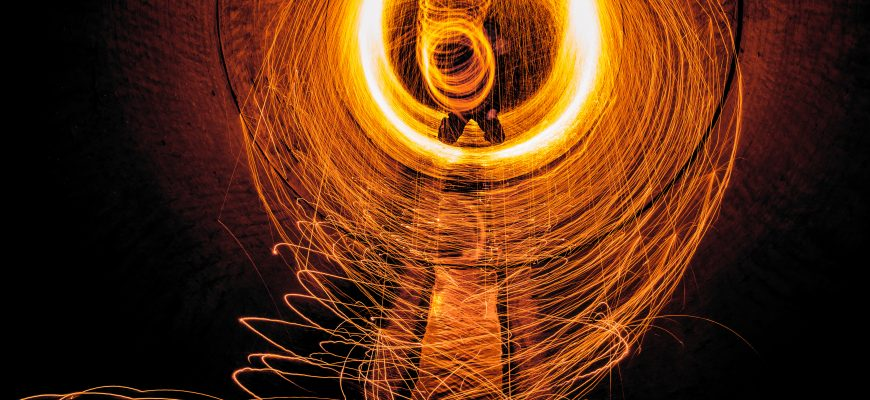 Sparks flying in circles off of a pipe.